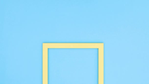 Empty photo frame on blue theme. Stop motion