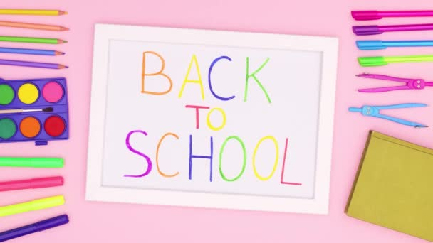 Back to school white frame on pink theme. Stop motion