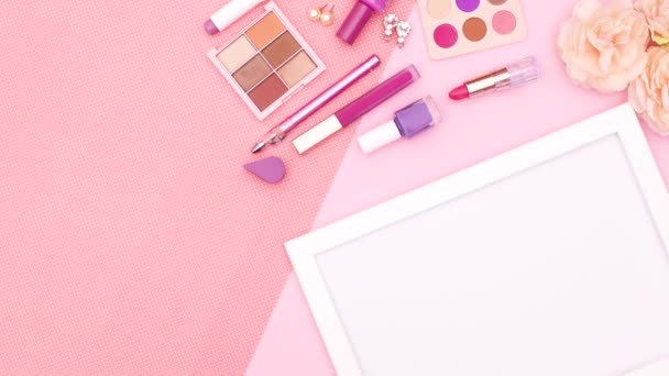 White empty frame for text or logo and make up and cosmetics products and woman accessories on pink theme. Stop motion