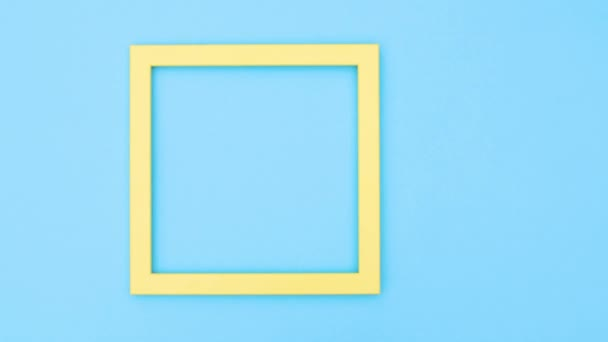 Empty photo frame with flowers on blue theme. Stop motion