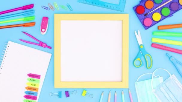 Yellow frame with white theme and school stationery on blue theme. Stop motion back to school