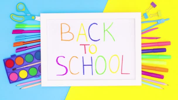 Back to school title inside of frame with school stationery. Stop motion animation o back to school stationery