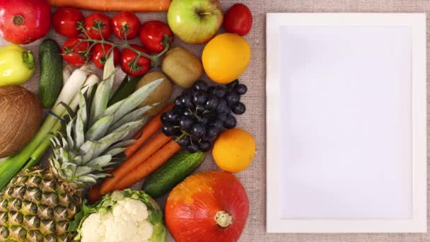 Frame for recipe on right side and fruits and vegetables on left side. Stop motion
