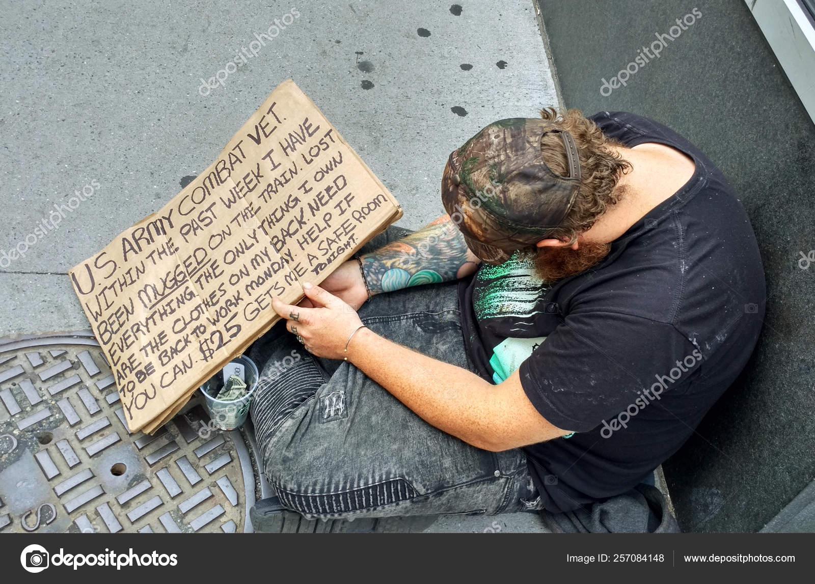 depositphotos_257084148-stock-photo-homeless-person-usa-new-york.jpg