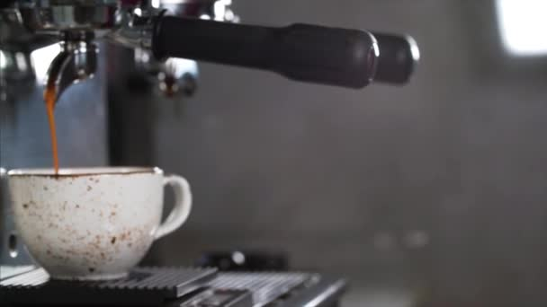Coffee machine is preparing fresh coffee and pouring into a cup at restaurant