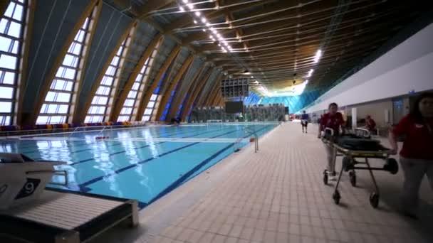 KAZAN, RUSSIA - 27 JULY 2015: Staff rolls empty stretcher in a pool of Aquatics Palace, 16th FINA World Championships.
