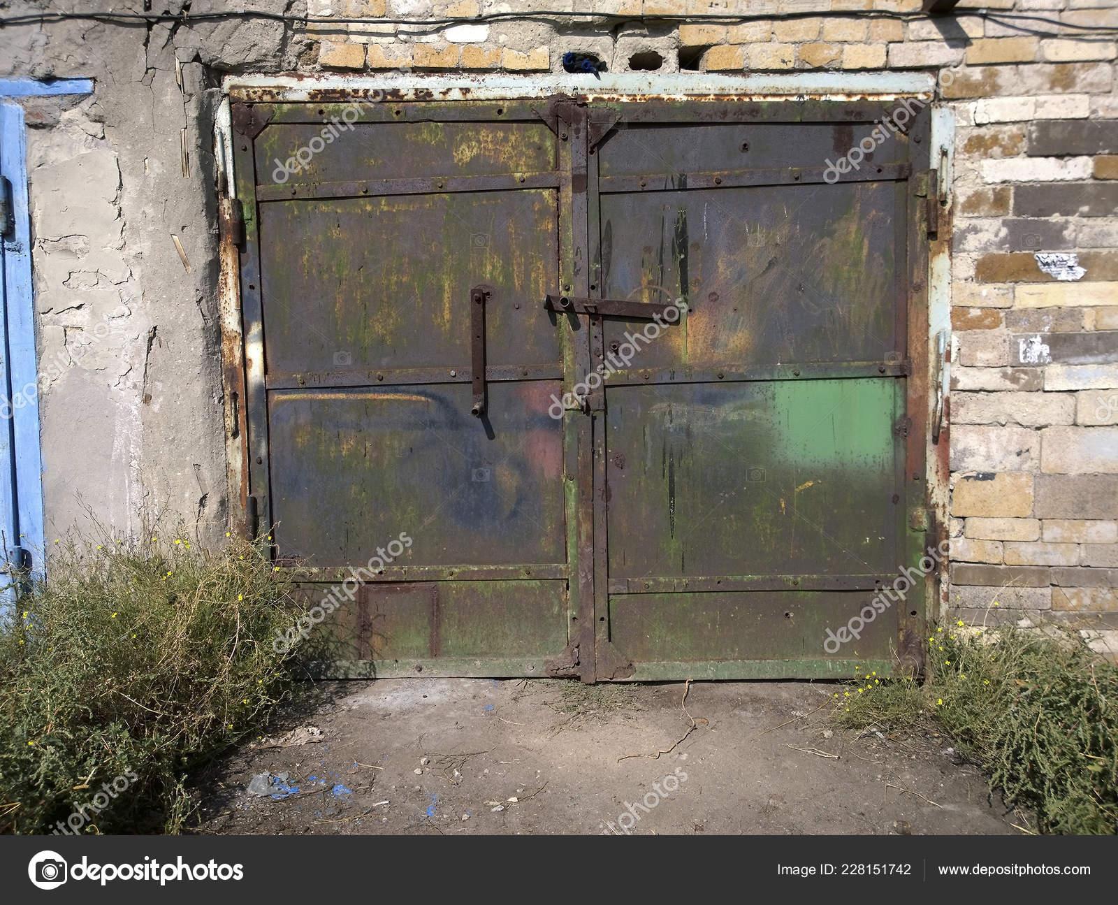 Old Metal Double Garage Doors Peeling Paint Surface Closed Screw Stock Photo By C Khalimosha 228151742