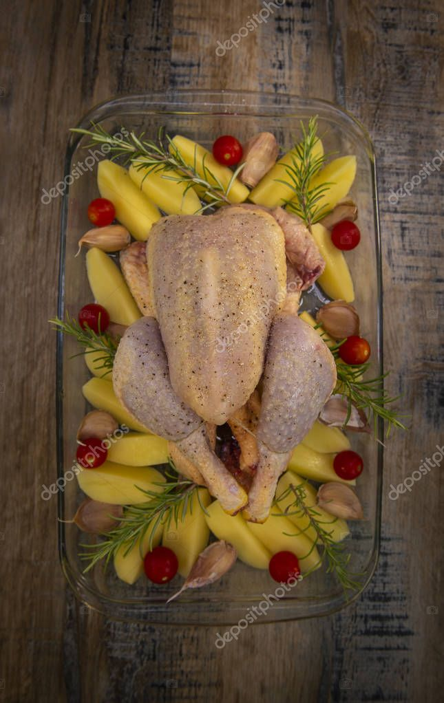 Fresh raw chicken and vegetables prepared for cooking, France