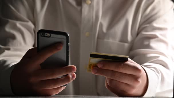 Man online banking using smartphone shopping online with credit card