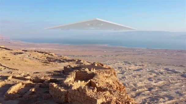 Large Triangle alien ufo over sea and desert mountains-AerialDrone view over Masada close to dead sea in Israel, Live footage with visual effect elements,4K