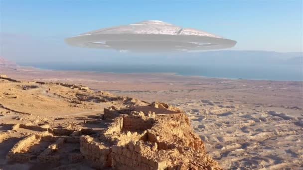 Large alien ufo saucer over sea and desert mountains-AerialDrone view over Masada close to dead sea in Israel, Live footage with visual effect elements,4K