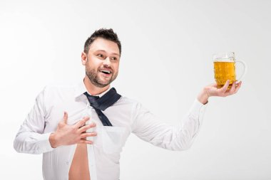 happy overweight man in tight shirt holding glass of beer and gesturing with hand isolated on white