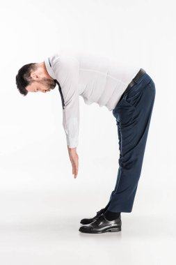 overweight man in tight formal wear bending over and stretching on white