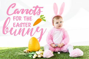 cute baby in bunny costume sitting near colorful chicken eggs, tulips and yellow ostrich egg with carrots for the Easter bunny illustration