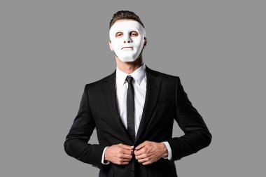 Confident handsome businessman in black suit and white mask isolated on grey stock vector