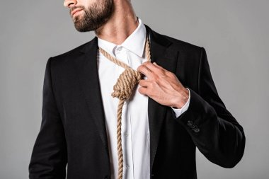 cropped view of depressed businessman in black suit with noose on neck isolated on grey