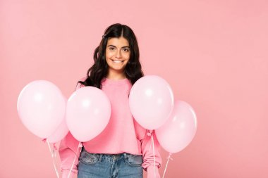 Beautiful smiling woman holding pink balloons, isolated on pink stock vector