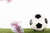 soccer ball near flying euro banknotes isolated on white, sports betting concept