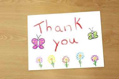 Drawing of thanks to the teacher on a sheet of paper on the table