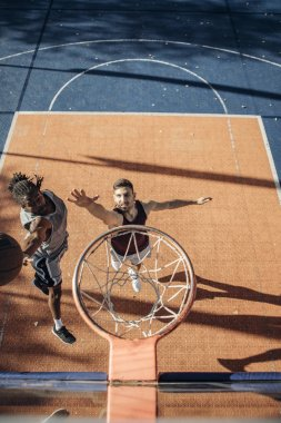 Two Basketball Players in a Duel
