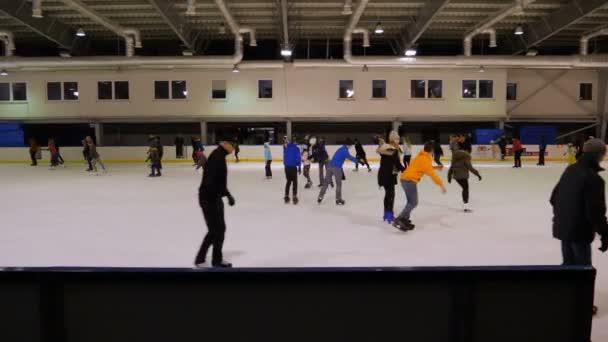 GDANSK, POLAND - FEBRUARY 2018: People ice skating. Ice skating rink.