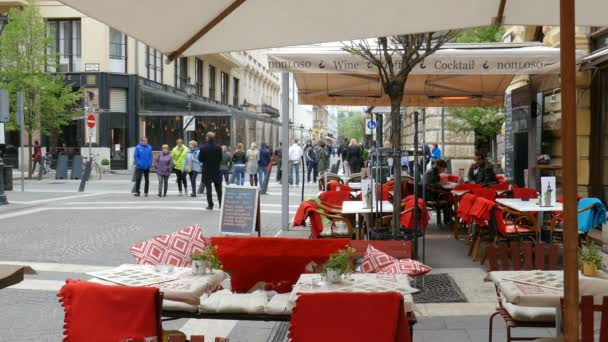BUDAPEST, HUNGARY - APRIL 2016: Budapest. Restaurant in city center and strolling tourists.