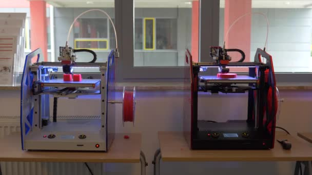 Two 3D Printers printing plastic parts