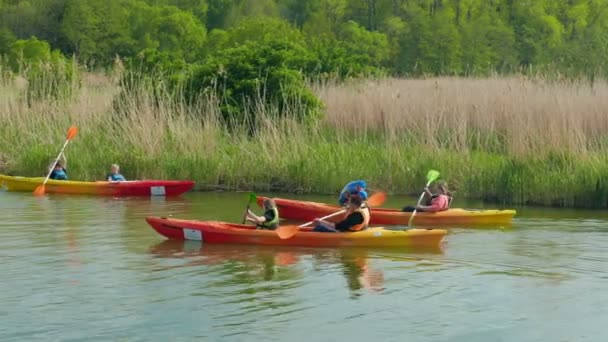 ZALEW WISLANY, POLAND - AUGUST 2015: Families with children kayaking in nature. Healthy lifestyle