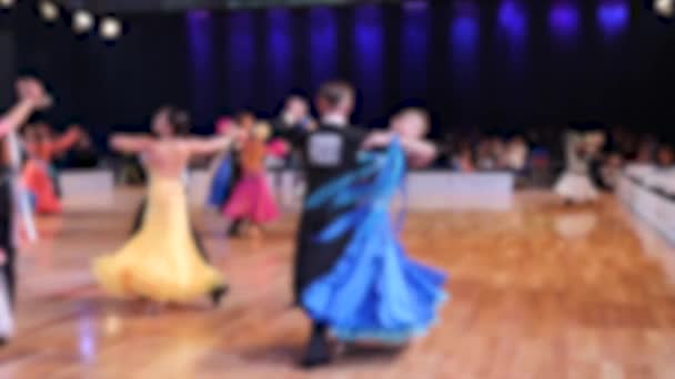 POLAND - OCTOBER 2018: Ballroom dancing. Anonymous defocused people dancing standard dances. Slow motion