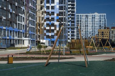 Improvement of yards of a modern residential complex I am a Romantic. Comfortable courtyards with playgrounds and outdoor furniture made of wood. Russia, St. Petersburg, Vasilyesky Island, May 25, 2018