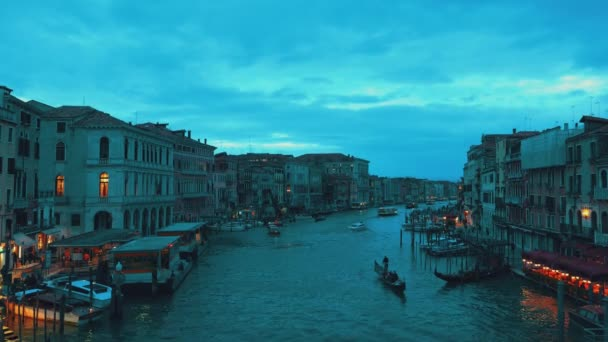 Beautiful night view to canal with gondola in Venice, Italy