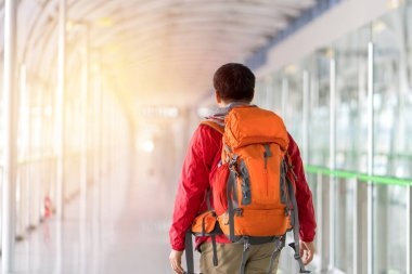 Young man traveling backpacker with Backpack in city concept.