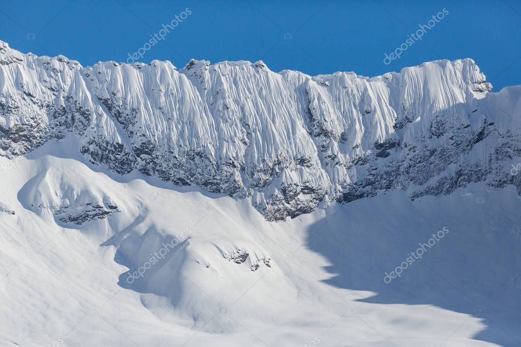 alpine mountain peaks and crests with snow in winter