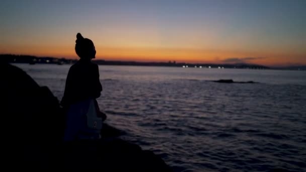 Dramatic Beach Sunset And Silhouette of young Woman