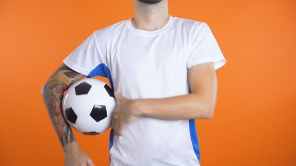 close up of Football fan or player holding ball isolated on black background