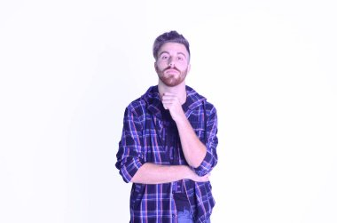 Young man worried looking at camera on isolated white background
