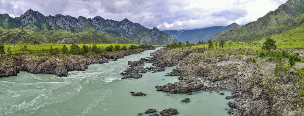 Summer landscape of fast mountain river Katun with Teldykpen rap