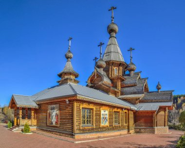 Novokuznetsk, Russia - October 09, 2018: Christian Temple of the Holy Martyr John the Warrior. Vintage technologies for the construction in traditions of wooden architecture of Russian North