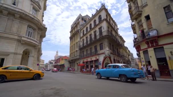 HAVANA, CUBA - MAY 13, 2018 - People and old taxi cars on the streets in 4k