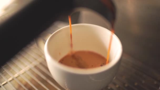 Coffee Maker Pouring Hot Espresso Coffee In A Cup in Slow Motion