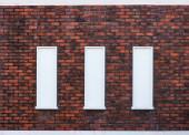 klasszikus Vintage Design ablak viharzott vörös téglafalak fal háttér.