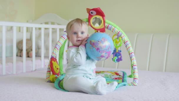 Baby playing with globe