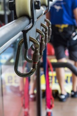 A row of metal carabiners. Bungee jumping attachment system. Selective focus