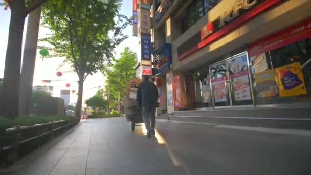 Man With Hand Truck at Dawn