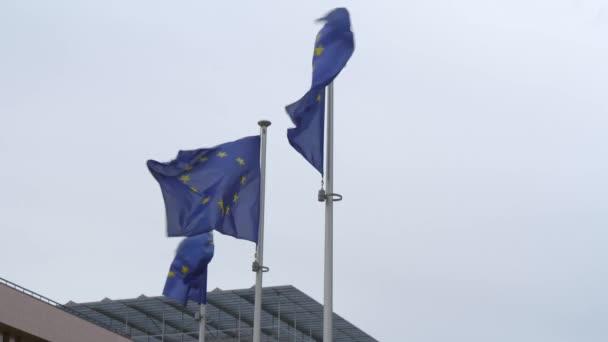 Three EU Flags on Flagpoles