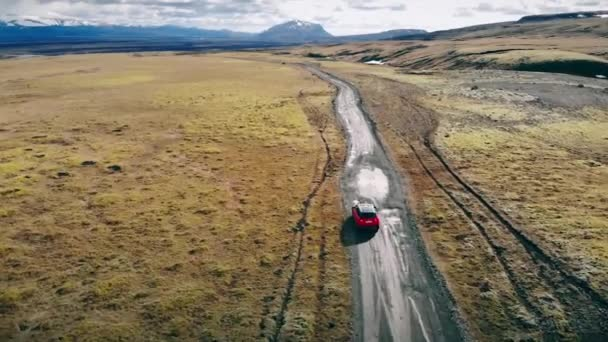 Red Car Driving Through Iceland.