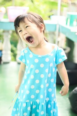 Cute girl happy time wearing blue dress
