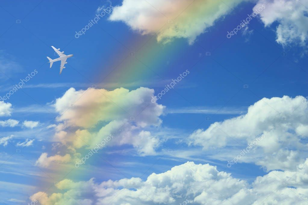 blue sky with white clouds and rainbow