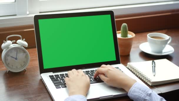 4K. close-up woman working with notebook laptop, using finger with keyboard for typing. computer laptop with blank green screen chroma key.