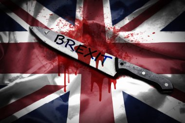 A long knife with the word Brexit stained with blood, placed on United Kingdom flag with blood spilled, Brexit concept